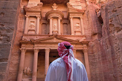 Arab Man Watching Facade Of Treasury Print by Keren Su