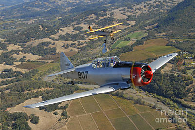 At-6 Texan And Stearman Pt-17 Flying Print by Phil Wallick