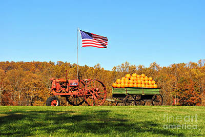 Wagon Wheel Red And Green Country Colored Grass Photograph - Autumn And Old Glory by Kelly Nowak