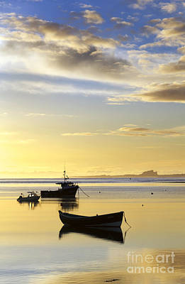 Lindisfarne Photograph - Bamburgh Castle From Lindisfarne by John Potter