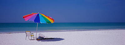 Empty Chairs Photograph - Beach Umbrella And A Folding Chair by Panoramic Images