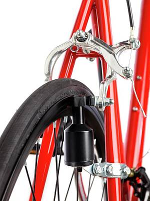 Dynamos Photograph - Bicycle Dynamo Fixed To Back Wheel by Science Photo Library