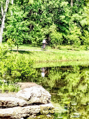 Landscape Photograph - Bicycling By The Lake by Susan Savad