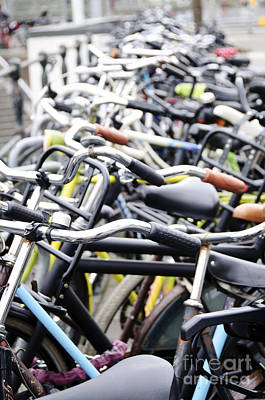 Amsterdam Photograph - Bicyles Parked Along The Street by Oscar Gutierrez