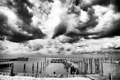 Big Clouds Little Dock Print by John Rizzuto