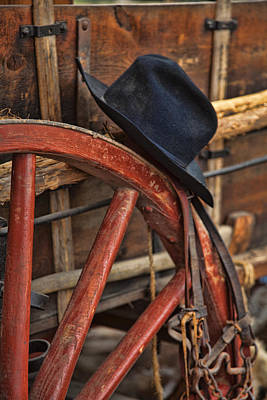 Black Hat On A Red Wagon Wheel Print by Toni Hopper