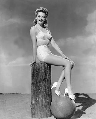 Two Piece Photograph - Blonde On A Piling by Underwood Archives