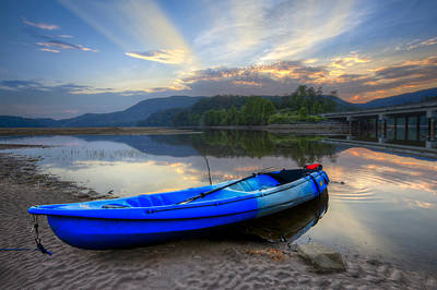 Blue Canoe At Sunset Print by Debra and Dave Vanderlaan