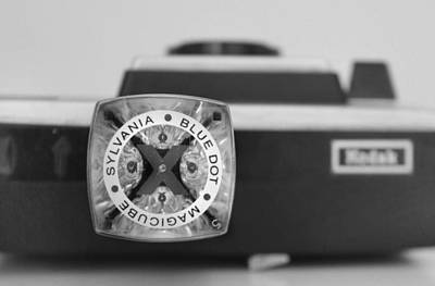 Kodak Photograph - Blue Dot Magicube In Black And White by Kelly Hazel