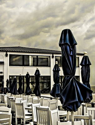 Empty Chairs Photograph - Blue Umbrellas by Colleen Kammerer