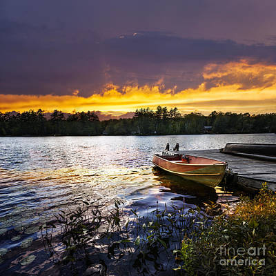 Boat On Lake At Sunset Print by Elena Elisseeva