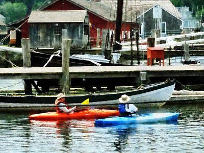 Port Photograph - Boat - Orange And Blue Kayaks by Susan Savad