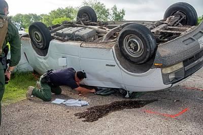 Border Patrol Officer Inspecting A Crash Print by Jim West