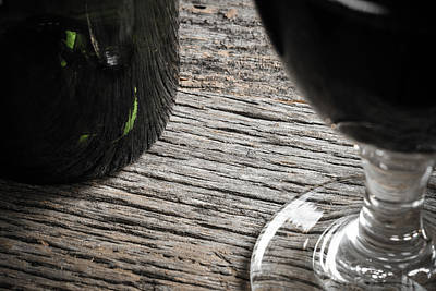 Vino Photograph - Bottle Of Wine And Glass Of Red Wine On Rustic Table by Brandon Bourdages