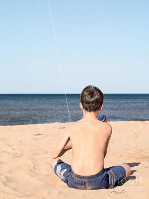 Boy At The Beach Flying A Kite Print by Edward Fielding