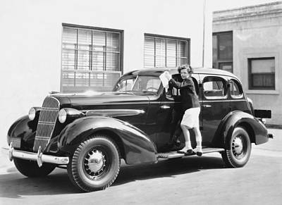 Adolescence Photograph - Boy Cleaning A Car by Underwood Archives