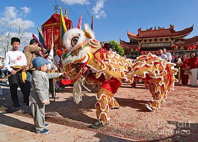 Gong Photograph - Boy Giving A Red Envelope Gift To A Lion Dancer. Chinese Lion Da by Jamie Pham