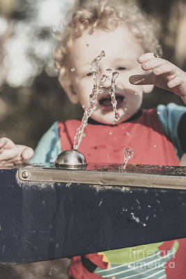 Water Play Photograph - Boy Mesmerised By The Element Of Water In Motion by Jorgo Photography - Wall Art Gallery