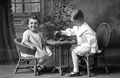 Boy Pours Sister A Cup Of Tea Print by Underwood Archives