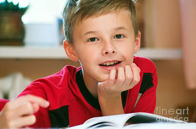 Indoor Photograph - Boy Reading Book Portrait by Michal Bednarek