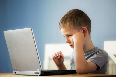 Boy Using Laptop Print by Samuel Ashfield