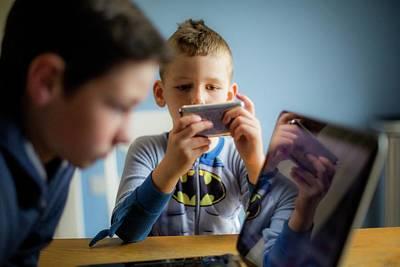 Boy Using Smartphone Print by Samuel Ashfield