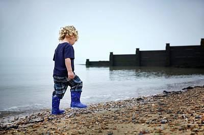 2 Solitudes Photograph - Boy Walking On Beach by Ruth Jenkinson