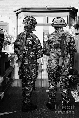 British Army Armed Soldiers In Riot Gear Watch Over House And Garden On Crumlin Road At Ardoyne Shop Print by Joe Fox