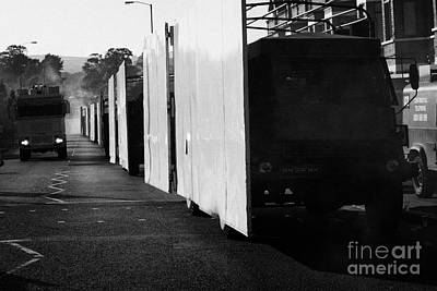 British Army Screen Bedford Trucks And Psni Water Canon On Crumlin Road At Ardoyne Shops Belfast 12t Print by Joe Fox