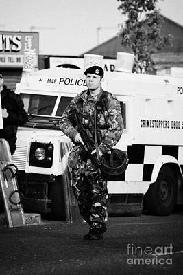British Army Soldier At Psni Landrover On Crumlin Road At Ardoyne Shops Belfast 12th July Print by Joe Fox