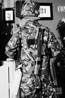 British Army Soldier In Riot Gear With Sa80 And Fire Extinguisher On Crumlin Road At Ardoyne Shops B Print by Joe Fox