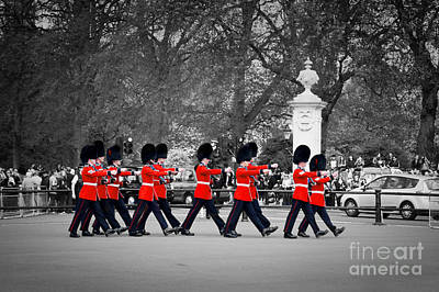 Change Photograph - British Royal Guards March And Perform The Changing Of The Guard In Buckingham Palace by Michal Bednarek