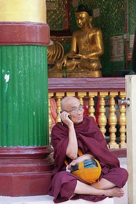 Buddhist Monk On Mobile Phone Print by Peter Menzel