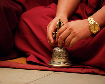 Buddhist Monk Playing Musical Bell Print by Jaina Mishra