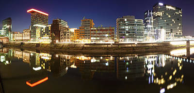 Haus Photograph - Buildings Lit Up At Dusk, Colorium by Panoramic Images