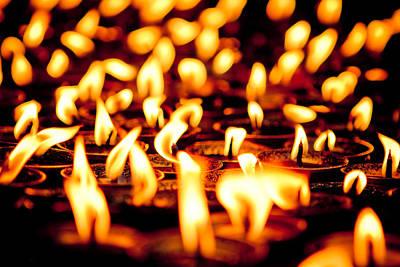 Travel Photograph - candle light in Boudnath stupa by Raimond Klavins