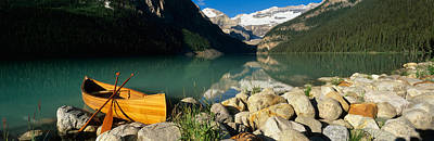 Spring Scenes Photograph - Canoe At The Lakeside, Lake Louise by Panoramic Images