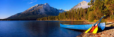 Reflections Of Sky In Water Photograph - Canoe In Lake In Front Of Mountains by Panoramic Images