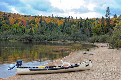 Canoe With An Engine Print by Les Palenik