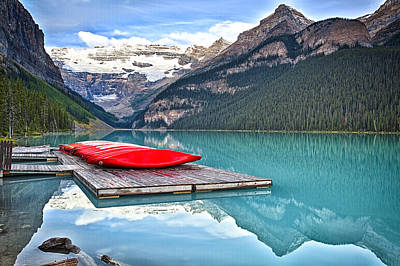 Canoes Of Lake Louise Alberta Canada Print by George Oze
