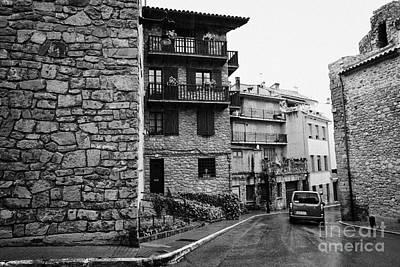 Antic Car Photograph - Car Driving Through Narrow Streets Of Old Town Of Medieval Baga Catalonia Spain by Joe Fox
