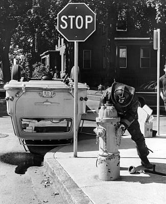 Car Flips Over At Stop Sign Print by Underwood Archives