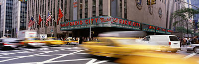 Stage Theater Photograph - Cars In Front Of A Building, Radio City by Panoramic Images
