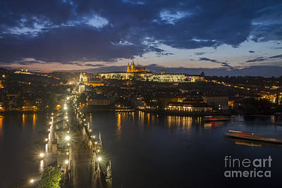 Charles Bridge And Prague Castle After Thunderstorm At Night Print by Bart De Rijk