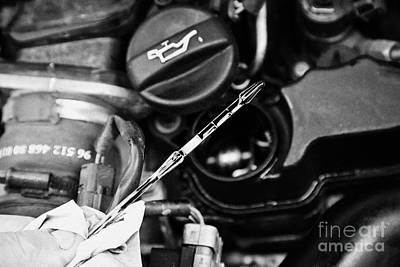 Checking The Oil Level On The Dipstick In A Car Engine Compartment Print by Joe Fox