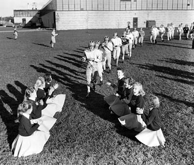 Cheerleaders Encourage Football Players Print by Retro Images Archive