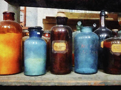 Science Photograph - Chemist - Orange Brown And Blue Bottles by Susan Savad