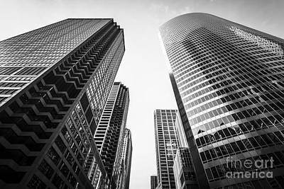 Between Photograph - Chicago Buildings Black And White by Paul Velgos