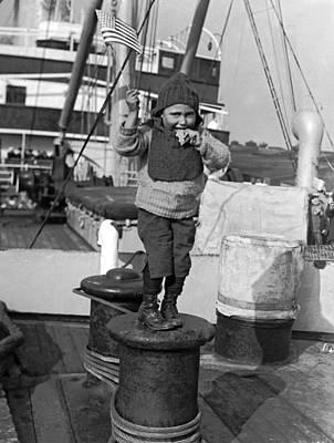 Ellis Island Photograph - Child Arriving At Ellis Island by Underwood Archives