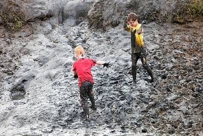 Children Playing In A Muddy Creek Print by Ashley Cooper